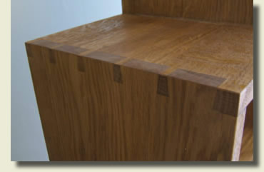 Stepped oak bookcase - detail of exposed dovetails