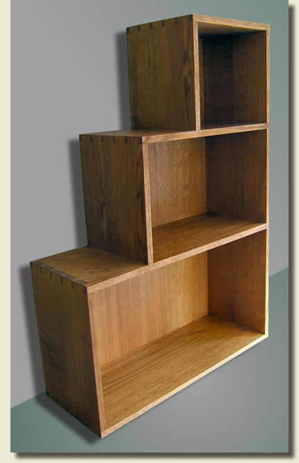 Contemporary stepped bookcase in English Oak